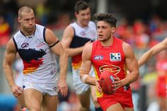 Dion Prestia of the Suns runs the ball during the round 14 AFL match between the Gold Coast Suns and the Adelaide Crows at Metricon Stadium on June 29, 2013 in Gold Coast, Australia. http://footyboys.com