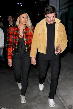 Matching: Zac Efron appeared to be coordinating with Sami Miró when the two attended the Lakers game on Friday night
