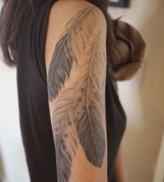 Girl's shoulder feather tattoo