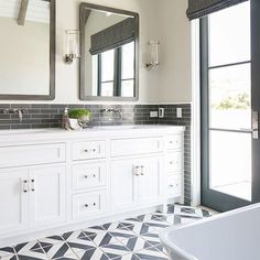 One of our faves... #masterbath #beachhouse #transitional #bwd #customhome #blacknwhite_perfection #freestanding🛁 Architeck- @brandonarchitects Builder- @pattersoncustomhomes 📷 @ryangarvin