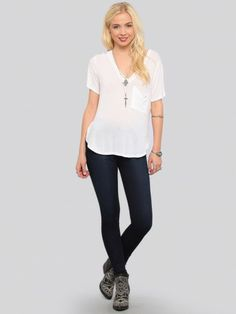 Comfy v-neck tee featuring a pocket at the wearer's left side and a rounded hi low hemline