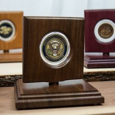 """Challenge Coin Rotating Display Case - Natural Black Walnut Wood - For 45mm (1.75"""") Coins. Perfect for challenge coins, corporate gifts, awards and more; the unique design and the natural beauty of the exotic woods we use make Coin Displays unlike any others. Beautifully designed to show both sides of your coins, our displays are a great way to showcase memories made or the prize pieces in your collection. The included crystal clear hard acrylic coin holder fits perfectly into the display… Coin Display Case, Challenge Coins, Discount Dresses, Discount Shoes, Walnut Wood, Corporate Gifts, Bookends, Clock, Discount Beauty"""