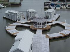 """Lake Erie Floating Homes is a revolutionary new concept in waterfront living. This """"On The Water"""" community is located at Lakefront Marina on Lake Erie in Port Clinton, Ohio, asubsidiary of Marinas International. Lake Erie Floating Homesis a revolutionary new concept in waterfront living. By combining a pre-constructed, self-contained home and a floating dock assembly we will put you not just near the water but right on the water."""