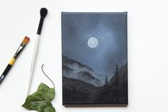 Misty mountains and full moon painting