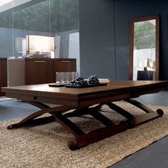 Adjustable height coffee/dining table                                                                                                                                                                                 More