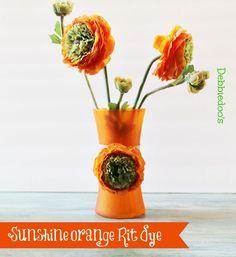 Painting a vase with sunshine orange Rit dye