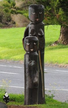 "Geelong, Victoria, Australia - ""Koori Family"" Bollards No 4 - A family illustrating the local hunter gatherer culture."