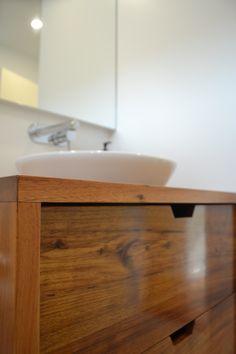 Timber (Tasmanian Blackwood) vanity with caroma Leda vasque inset basin. Custom built in mirrored cupboard. Gareth Ashton tap/spout