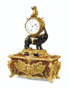 A PATINATED AND GILT-BRONZE MOUNTED MUSICAL CLOCK SIGNED S. GERMAIN, LOUIS XV, CIRCA 1750-1760, THE SATINÉ PEDESTAL STAMPED ST. GERMAIN