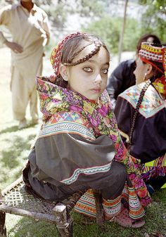 Kalish girl - The Kalash are a tiny and dwindling community of non-muslims living in two valleys in the Hindu Kush mountains in Pakistan's North-West Frontier Province. (Frontier as in the frontier with Afghanistan)  Kalash culture and belief system differs drastically from the various ethnic groups surrounding them but is similar to that of the neighboring Nuristanis (Kafirs) in northeast Afghanistan, before their enforced Islamization in the last decade of the 19th century