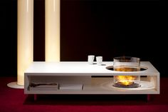 """Coffee Fire Long"" basically, a long coffee table with integrated fireplace. By Planika"