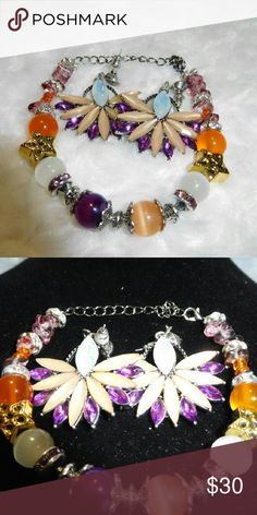 Passion Blossoms Bracelet and Earring Set Peach, Orange and Purple jade beads, along with purple and clear crystal spacers, rose chips, star charms, orange accent beads and Tibetan spacer beads make up this candy bracelet. 26 cm length Handmade Jewelry