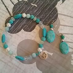 Turquoise stone and bead necklace and earring set Never worn. Stretch bracelet with small peace sign charm. Real pearl beads and other varied beads. Drop earrings. Pretty sure all sterling silver. Jewelry