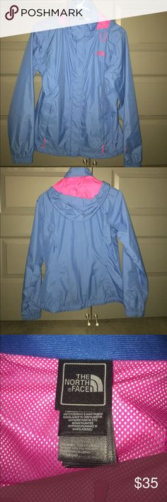 Women's Northface raincoat Blue and pink rain coat, size medium, hood can be rolled and tucked into compartment. Very light but keeps you dry. Although it's been worn it looks and feels brand new- in great condition North Face Jackets & Coats