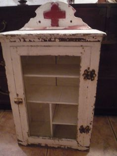 Paint Red Cross on my chippy cabinet then fill it with old bandages. Vintage Medicine Cabinets, Wall Display Cabinet, Glass Cabinets Display, Primitive, Cabinet, Primitive Bathrooms, Primitive Furniture, Shabby, Vintage Furniture