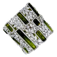 """Peridot & Diamond Soft Bracelet from """"GOLDIVA"""" Collection by Golda Co. Contains carats of Peridot gemstones surrounded by carats of marquise and brilliant round cut diamonds. Modern Jewelry, Vintage Jewelry, Fine Jewelry, Diamond Bracelets, Bangle Bracelets, Diamond Jewelry, Bangles, Peridot Jewelry, Peridot Bracelet"""