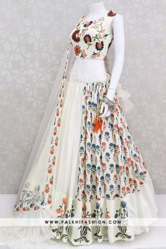 Designer Premium Off White Chaniya Choli With Appealing Designs & Work Palkhi fashion off white silk chaniya choli set with printed designs.soft organza dupatta with splitted ruffle pattern.Trendy coolection from palkhi fashion Party Wear Indian Dresses, Designer Party Wear Dresses, Indian Gowns Dresses, Indian Bridal Outfits, Dress Indian Style, Indian Fashion Dresses, Indian Designer Outfits, Pakistani Clothing, Wedding Dresses