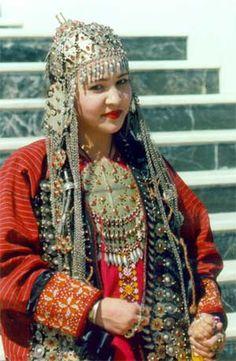 Woman dressed in traditional Turkmen headdress and jewellery.