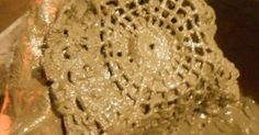 She dips a doily in a pan of cement. Why? This countertop idea is incredible!