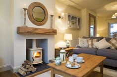 The cosy and luxurious sitting room at Plum Tree Cottage in Keswick. The owner i… The cosy and luxurious sitting room at Plum Tree Cottage in Keswick. The owner is an interior designer and the house is beautifully furnished throughout. Cottage Living Rooms, Cottage Interiors, New Living Room, Home And Living, Living Spaces, Cosy Living Room Small, Modern Living, Blue And Cream Living Room, Living Area