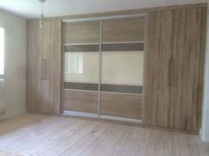 Love the symmetry of this one. Sliding wardrobes combined with hinged doors is a great look.