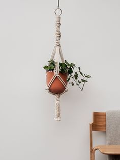 Start making a tropical paradise inside your home with this plant hanger.  Designed and handmade by us, this Macrame is made from 6mm 100% natural cotton rope and measures approx 105cm. Handmade terracotta pot also available from our Etsy store.