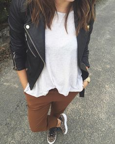 Instagram ... black leather moto , brown / nutmeg trousers and leo sneaks