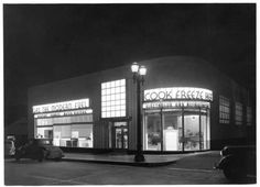"""1930s appliance showroom. losangelespast: """" """"Gas: The Modern Fuel"""": The Los Angeles Gas and Electric showroom at night, 1937. The company was purchased by the city and merged with the DWP shortly after this photo was taken. """""""