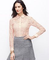 Winter Lace Top - New romantic: lovely lace paired with faux leather accents redefines modern femininity. Add a cami beneath for more coverage. Point collar. Long sleeves with button closure. Button front. Shirttail hem. Faux leather collar and cuffs.