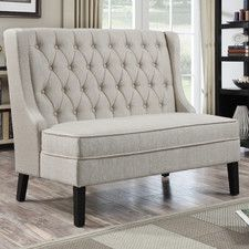 Features:  -Back is inset by shaped wings and folded seams.  -Back is angled and not straight.  Bench Type: -Bedroom bench.  Seat Material: -Fabric.  Finish: -Ebony Stain.  Style: -Traditional. Dimens