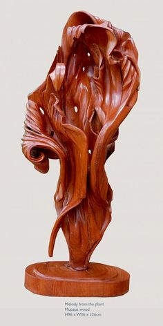 Mupapa wood #sculpture by #sculptor Charles Chambata titled: 'Melody from the Plant (abstract Wood statuettes)'. #CharlesChambata