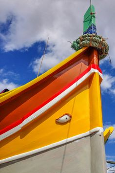 """One of the top things to do in Malta: Visit the Marsaxlokk Harbor to see the colorful, traditional Maltese fishing boats, called """"luzzus."""" The boats have an eye painted on the front that is believed to protect the fishermen when they are out at sea. Visit on Sunday morning to see the popular Marsaxlokk public market!"""