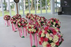 Preparing for our chinese clients with a mix of shades of pink roses blending beautifully wtih white roses, greenery and ribbon.