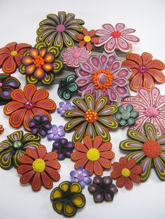 Clay Flowers... Polymer clay inspiration.... Can't wait to try something like these