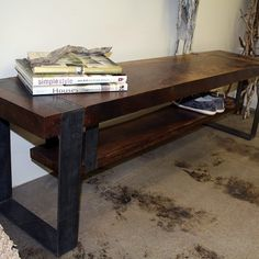 The union of rustic steel and thick cut walnut present a strong, masculine temperament. It is always hard at work to maintain entryway organization with a suspended 1 1/2″ slab shelf for shoes and boots. The thick steel strapping further enforces the durability and substance of the Strapped Bench.  • 2 1/2″ thick walnut slab top •  1 1/2″ thick walnut shoe shelf  • Wood treated with a matte clear coat  • Carved wood to achieve a flush profile with  • metal straps