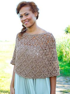 Lisbon is a beautiful lace poncho crocheted in the round from the top down.