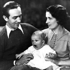Walt and Lillian Disney with their first daughter Diane, 1933.