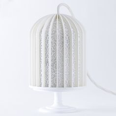 Avoid ugly boxy speakers with Nendo's Birdcage version.