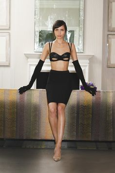 Innerwear Trend: Notes of a Scandal (Something Wicked's leather and suede bra with Rhonda Shear Ahh Lifestyle Collection's nylon and spandex shaper skirt. Dogeared necklace; Carolina Amato Accessories gloves; Emy Mack pumps.)