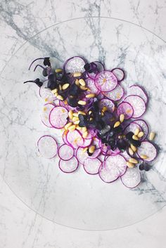 carpaccio: shaved purple radishes with radish sprouts, pine nuts, lemon zest…