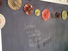 Dry erase re-done with chalkboard paint -- this page is full of great ideas for a budget craft room