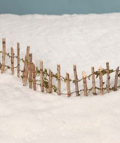 "An adorable little rustic fence for woodland Christmas villages, fairy gardens, gnome houses and putz house displays. - Wired sticks with greenery. - 6"" tall x 17"" long. - Bethany Lowe Christmas. - Im"