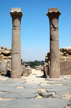 Two red granite palm columns standing in Sahu-Re's Royal Cult temple attached to the east side of his Pyramid at Abusir. Abusir Pyramid Complex, Egypt.