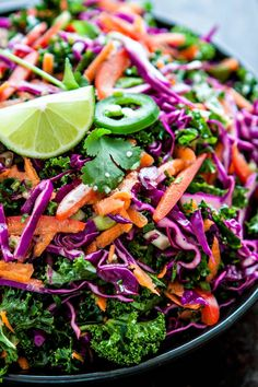 Kale, purple cabbage, carrot, and red bell pepper are tossed with a jalapeño lime vinaigrette for a healthy Mexican inspired Cilantro Lime Kale Slaw. Purple Cabbage Recipes, Purple Cabbage Slaw, Slaw For Shrimp Tacos, Spicy Fish Tacos, Homemade Coleslaw, Cilantro Lime Vinaigrette, Cilantro Lime Shrimp, Kale Slaw, Carne Asada