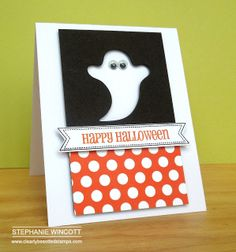 handmade Halloween card ... graphic look ... black panel with negative space die cut ghost ... cute google eyes attached to the main card ... fishtail banner with sentiment ... orange polka dot patterned paper on bottom part of the panel ... great look!! ... Clearly Besotted Stamps ...