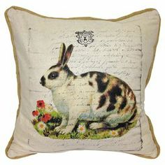 """Cotton and linen pillow with a rabbit motif and faded script background.   Product: PillowConstruction Material: Cotton and linen blend cover and fiber fill Color: MultiFeatures:  Insert includedPiped edgeDimensions: 20"""" x 20""""Cleaning and Care: Dry clean"""