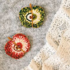 A personal favourite from my Etsy shop https://www.etsy.com/listing/604739122/apple-brooch-beaded-brooch-red-apple