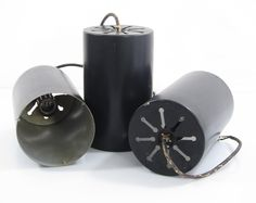 Three black metal Raak sixties cylinder pendant lamps. They have signs of use.  Dimensions: Height 22 cm, diameter 13,5 cm.  € 125,- each