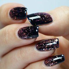 Black/Dark Blue nail with pink glitter