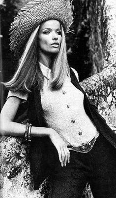 Veruschka in navy blue pants and vest worn over beige shirt of cotton toile by Renee Veron, photo by Rubartelli, French Vogue, Apr.1969